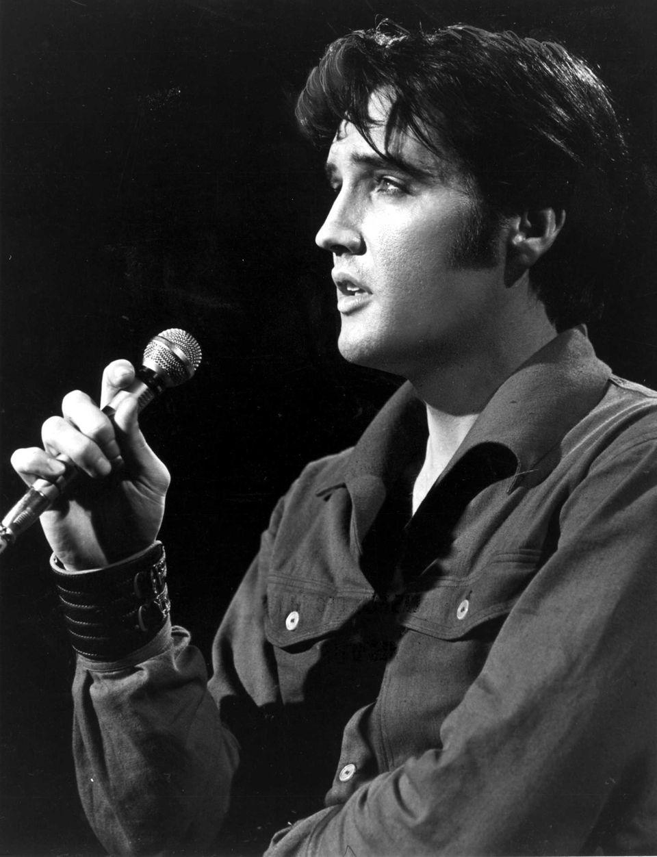 Elvis Presley sings romantic ballads in