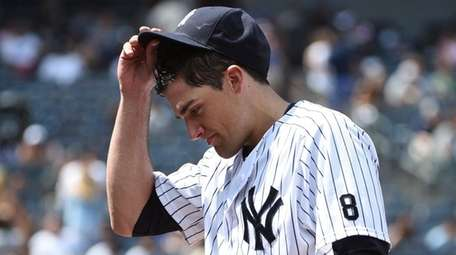 Yankees starting pitcher Nathan Eovaldi walks to the