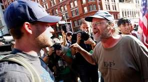 A protester, right, argues with a Trump supporter