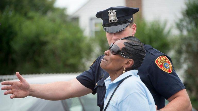 A Suffolk County police officer tells Pamela Woolridge