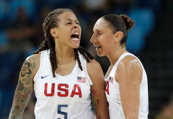 United States' Seimone Augustus (5), with teammate Diana