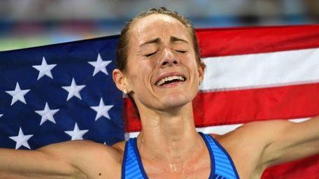 Bronze medallist USA's Jennifer Simpson celebrates after the