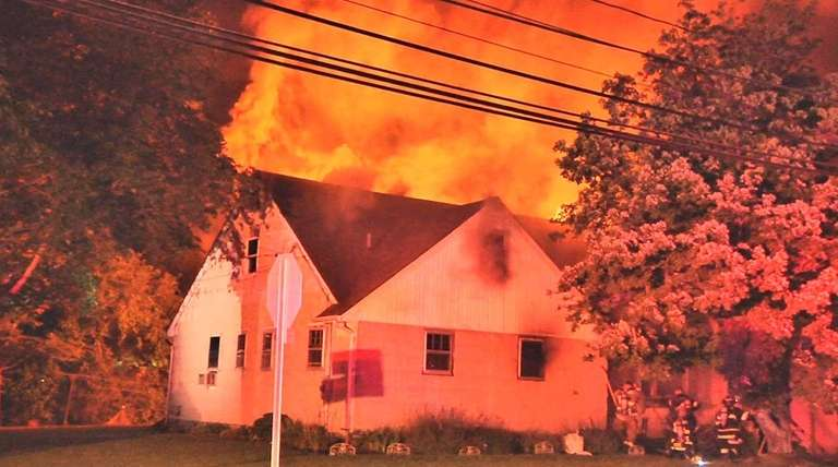 Firefighters from four departments in Suffolk County battled
