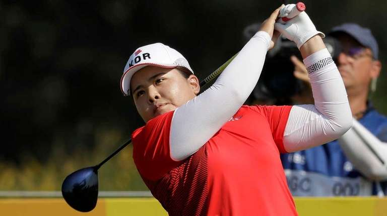 Inbee Park of South Korea, watches her tee