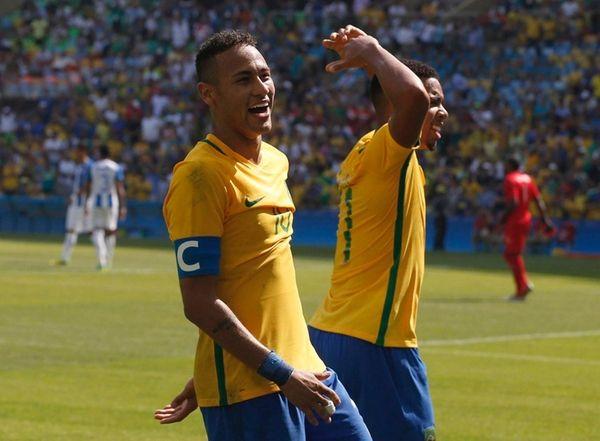 Gabriel Jesus of Brazil, right, celebrates his goal