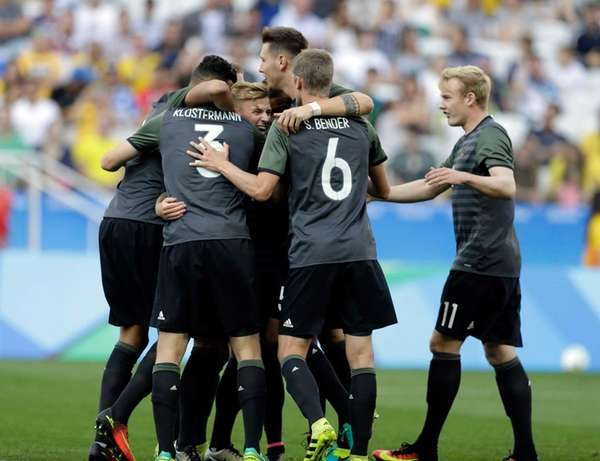 Germany's players celebrate after Germany's Lukas Klostermann scored