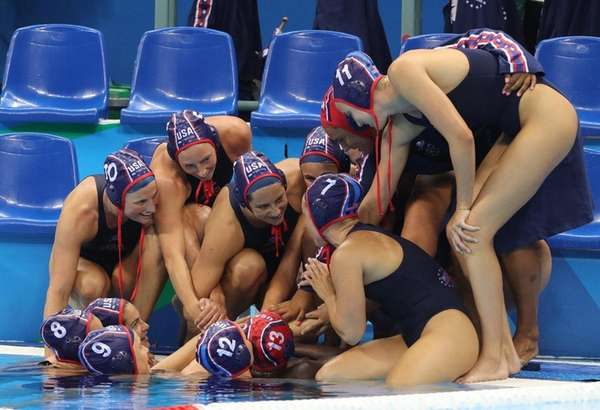 Team USA celebrates winning the women's water polo