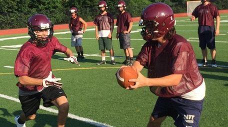 North Shore quarterback Ryan Aughavin hands off during