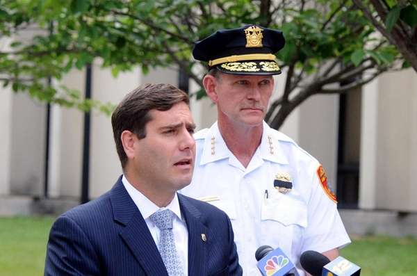 Suffolk County commissioner Tim Sini, left, during a