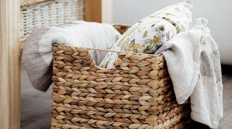 Place extra pillows and blankets in a decorative