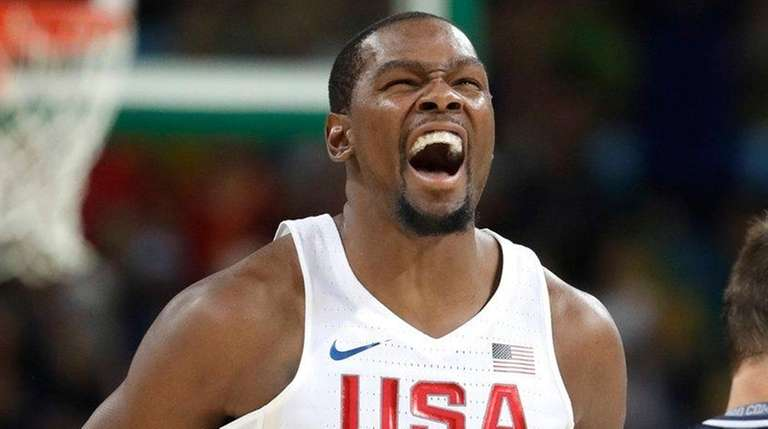 The United States' Kevin Durant (5) reacts to