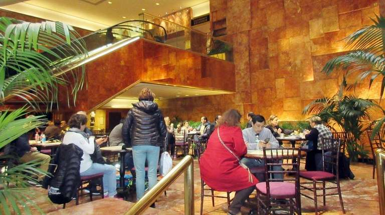 Visitors sit in the lobby of Trump Tower