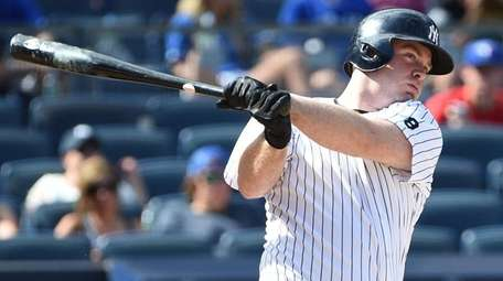 New York Yankees pinch hitter Brian McCann grounds