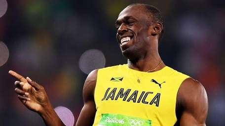 Usain Bolt of Jamaica reacts after competing in