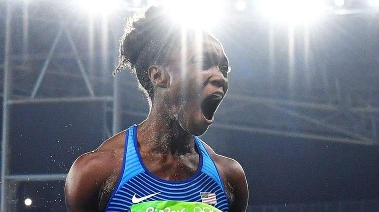 Tianna Bartoletta of the USA celebrates after jumping