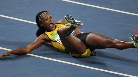 Elaine Thompson of Jamaica reacts after winning the