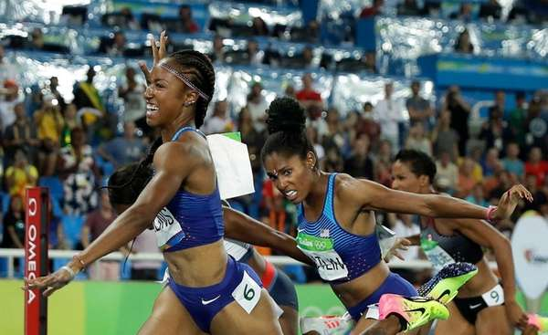 Brianna Rollins from the United States celebrates after