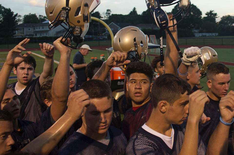 Bethpage players celebrate the end of practice at