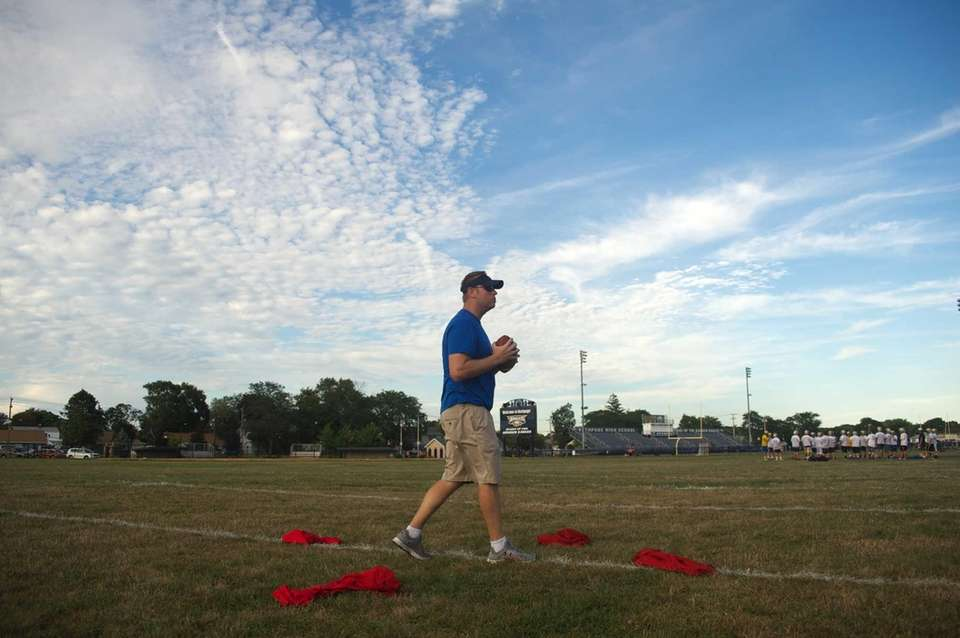 Coach Mike Whalen gets ready to throw a