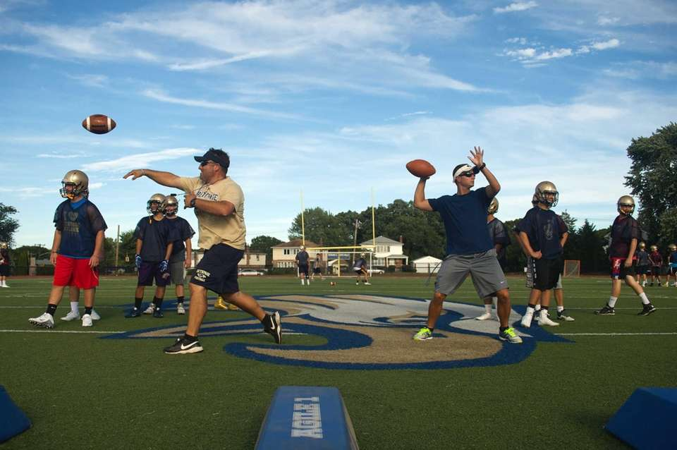 Coaches Michael Lewis and Pete Zito throw passes