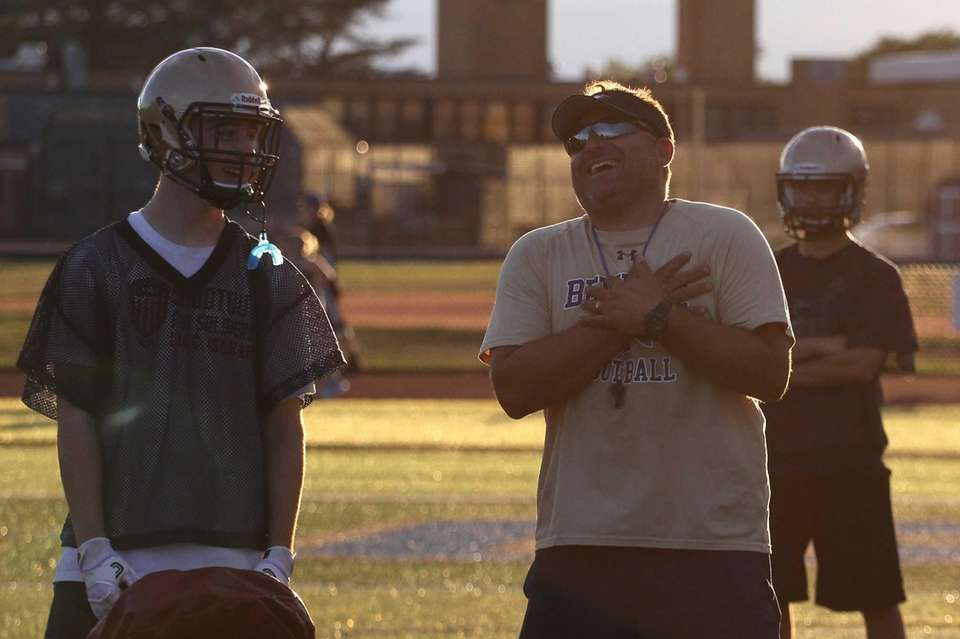 Coach Mike Lewis talks to a player during