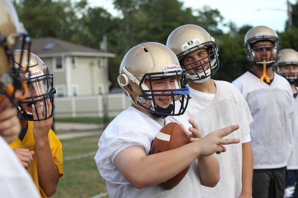 Players joke around during practice at Bethpage High