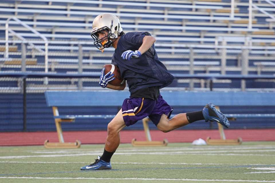 Jake LaSalla runs with the football during practice