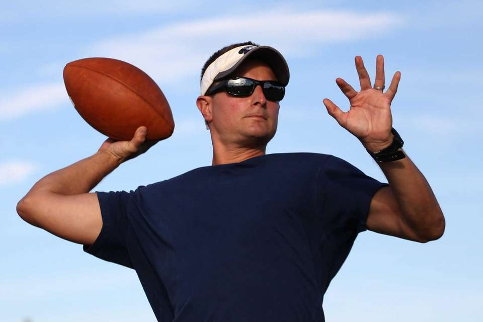 Pete Zito throws a pass during practice at