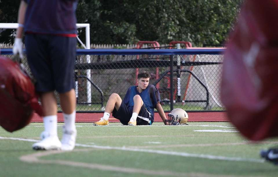 Mark Rossini takes a break during practice at