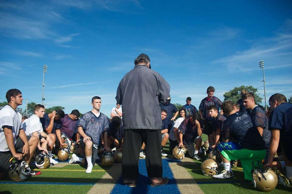 Head coach Erwin Dill gives instructions before practice
