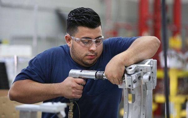 Franklin Argueta assembles aircraft parts on June 21,