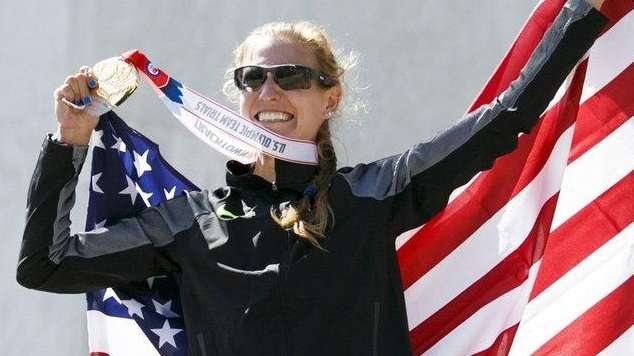 Winner Maria Michta-Coffey holds up her medal and