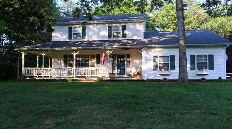 This Yaphank Colonial with three bedrooms and 2.5