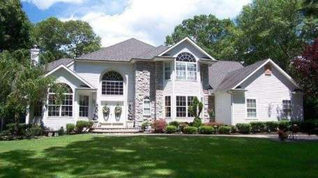 This Yaphank Colonial with five bedrooms and 3.5