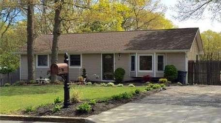 This Yaphank ranch with three bedrooms and one
