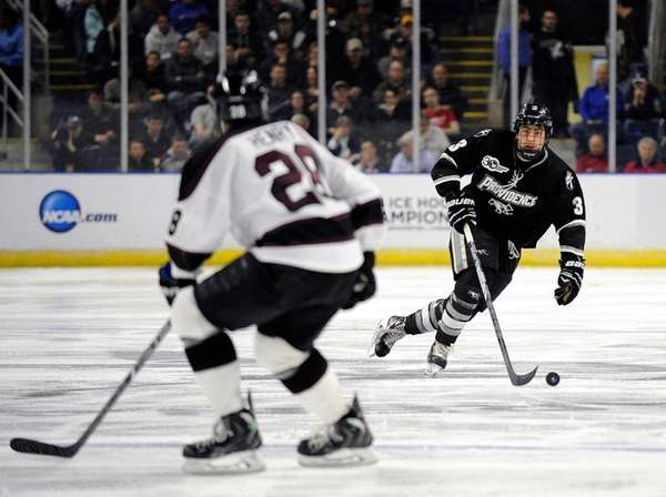 Providence's John Gilmour heads up ice as Union's