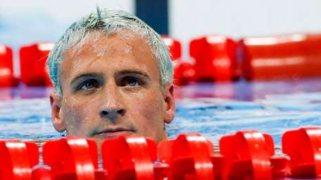 Ryan Lochte reacts after competing in the men's