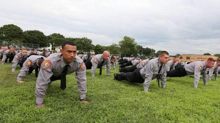 Nassau County police recruits participate in a 22-push-up
