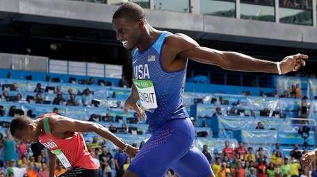 United States' Kerron Clement crosses the line to