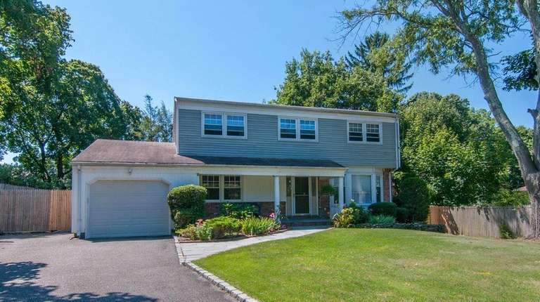 This East Norwich four-bedroom Colonial is on the