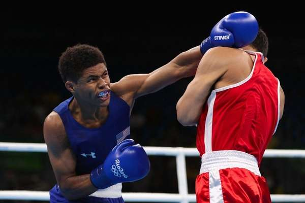 Shakur Stevenson, left, of the United States throws