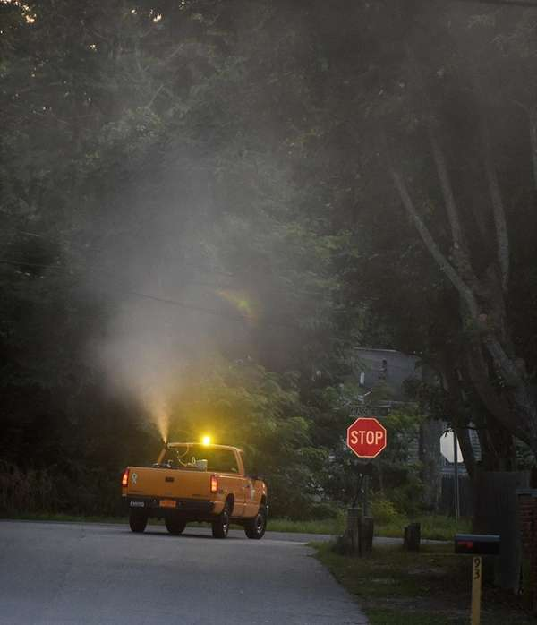 Suffolk County public works department ground sprays for