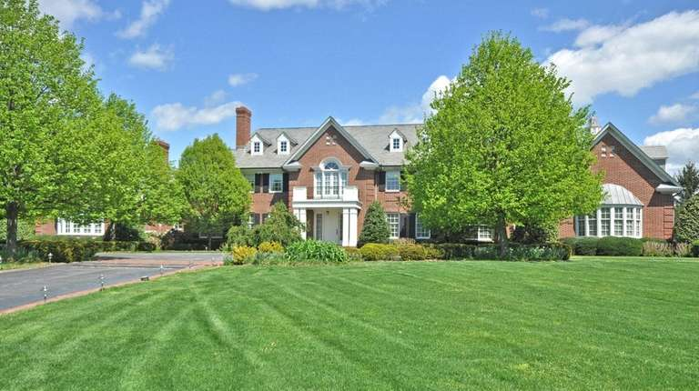 This Colonial in Old Westbury sits on almost