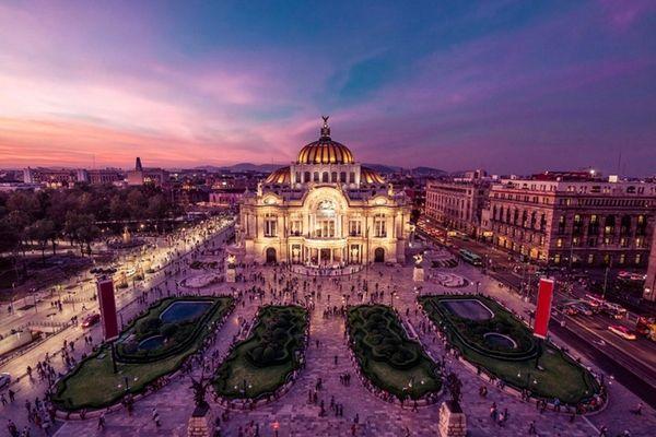 Mexico City's Palacio de Bellas Artes at twilight.