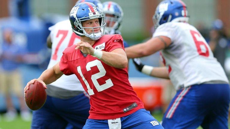 New York Giants quarterback Ryan Nassib (12) drops