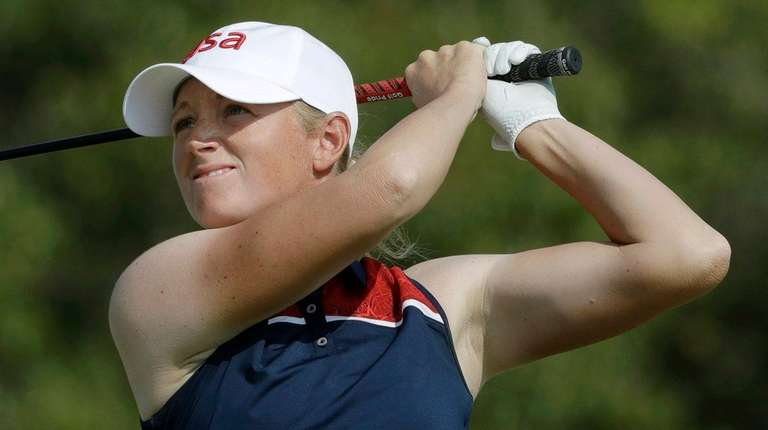 Stacy Lewis of United States, watches her tee