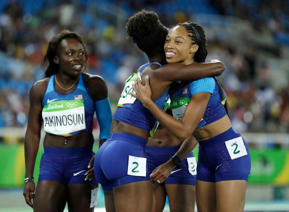 United States' Tianna Bartoletta hugs her teammate Allyson