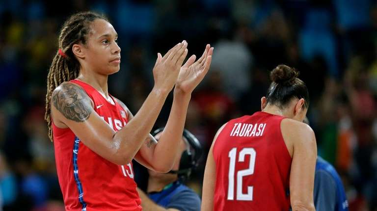 The United States' Brittney Griner reacts to fans