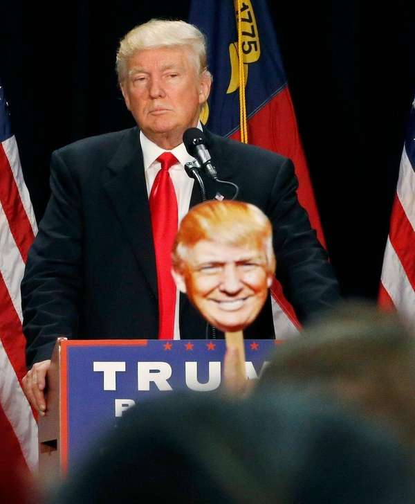 Republican presidential candidate Donald Trump pauses while speaking