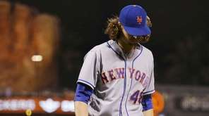 New York Mets starting pitcher Jacob deGrom walks